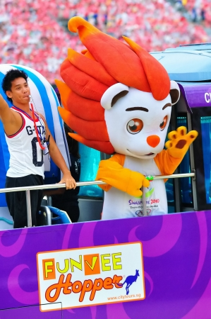 yog: Youth Olympics Game mascot, Lyo, waving to audience during National Day Parade Combined Rehearsal July 03, 2010 in Singapore Editorial