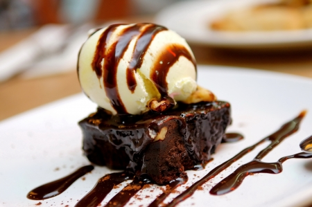 Chocolate brownie with vanilla ice-cream and chocolate sauce Stock Photo
