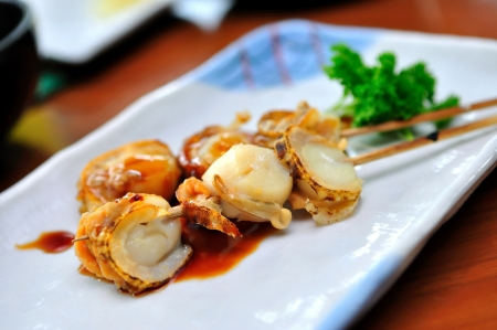 hotate: Japanese grilled hotate  scallop  skewers served on a plate