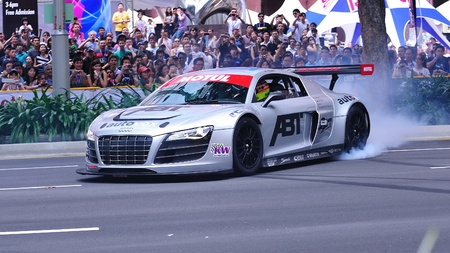 SINGAPORE - APRIL 24: Audi R8 LMS performing burnouts during Red Bull Speed Street Singapore on April 24, 2011 in Singapore