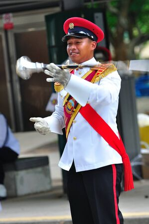Drum major practicing during National Day Parade Combined Rehearsal June 19, 2010 in Singapore
