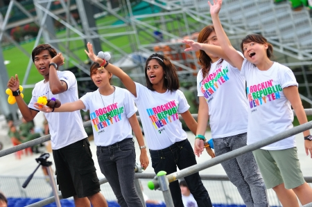 Young motivators cheering during National Day Parade Combined Rehearsal June 19, 2010 in Singapore