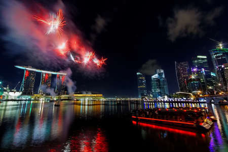 Fireworks over Marina Bay during Singapore National Day Parade 2010 Combined Rehearsal July 17, 2010 in Singapore Stock Photo - 16817331