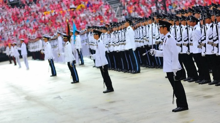 Guard-of-honor contingents standing at attention during National Day Parade Combined Rehearsal July 03, 2010 in Singapore Stock Photo - 16817731