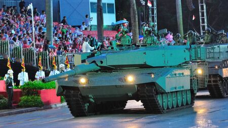 Leopard tanks parading the street during National Day Parade Combined Rehearsal July 03, 2010 in Singapore