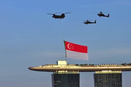during the day: Fly past of Singapore flag during Singapore National Day Parade 2010 August 09, 2010 in Singapore Editorial