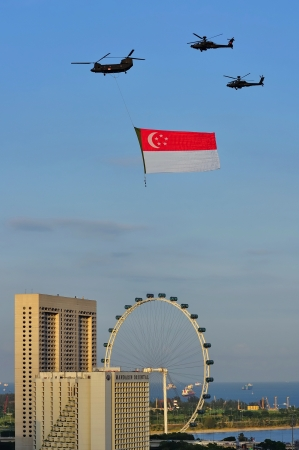 Fly past of Singapore flag during Singapore National Day Parade 2010 at the Padang August 09, 2010 in Singapore