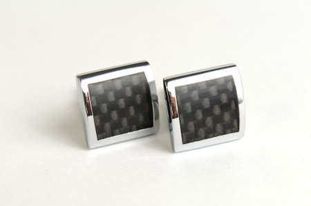 comtemporary: Square cuff links with carbon fibre panels Stock Photo