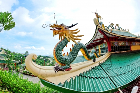 elaborate: Sculpture of a dragon on the roof of the Taoist Temple in Cebu