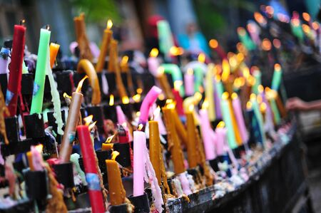 offered: Colorful burning candles offered for prayers