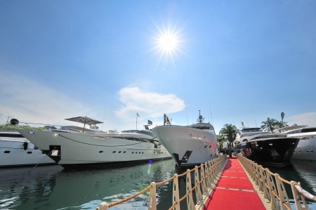 Line of super luxury yachts at the Singapore Yacht Show 2013 at One Degree 15 Marina Club, Sentosa Cove April 20, 2013 in Singapore