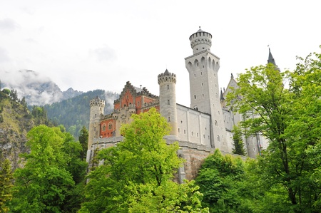 Famous Neuschwanstein Castle on top of the hill, in Schwangau, Germany