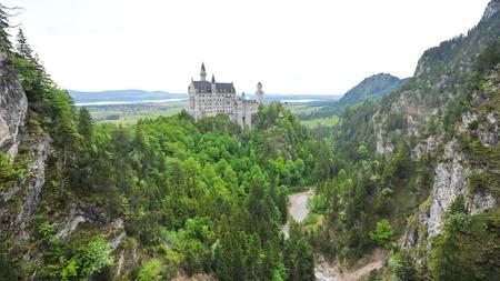 schwangau: Famous Neuschwanstein Castle overlooking the surrounding valley and meadow, in Schwangau, Germany