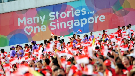 SINGAPORE - JULY 20  Spectators waving Singapore flags during National Day Parade  NDP  Rehearsal 2013 on July 20, 2013 in Singapore Editorial