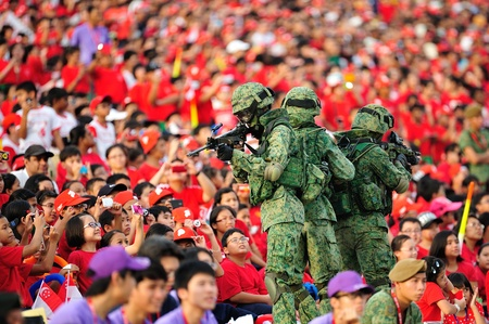 SINGAPORE - JULY 20  Soldiers moving amongst the spectators during National Day Parade  NDP  Rehearsal 2013 on July 20, 2013 in Singapore Editorial