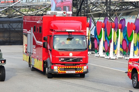 mitigation: SINGAPORE - JULY 20  Singapore Civil Defense Force  SCDF  hazardous materials mitigation vehicle arriving on scene during National Day Parade  NDP  Rehearsal 2013 on July 20, 2013 in Singapore