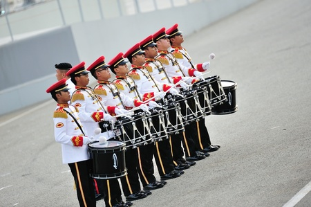 SINGAPORE - JULY 20: Singapore Armed Forces (SAF) band drummers performing during National Day Parade (NDP) Rehearsal 2013 on July 20, 2013 in Singapore