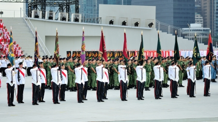 SINGAPORE - JULY 20: Colors Party standing at attention during National Day Parade (NDP) Rehearsal 2013 on July 20, 2013 in Singapore