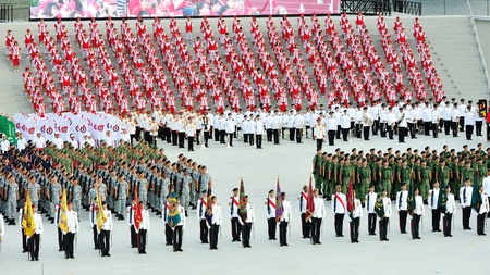SINGAPORE - JULY 20: Contingents standing at attention during National Day Parade (NDP) Rehearsal 2013 on July 20, 2013 in Singapore