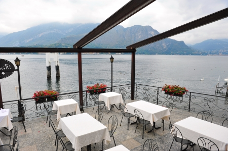 Restaurant with alfresco dining area beside Lake Como in town of Bellagio, Italy