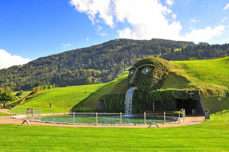 The Giant face and water feature, marking the entrance to Swarovski Crystal World in Watten, Austria