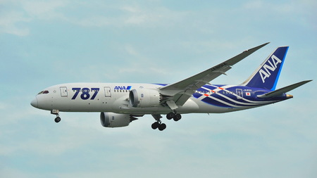 SINGAPORE - DECEMBER 25:  First Boeing 787 (Dreamliner) of All Nippon Airways (ANA) fleet landing at Changi Airport on December 25, 2013 in Singapore Editorial