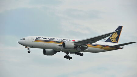 SINGAPORE - DECEMBER 25:  Singapore Airlines Boeing 777 landing at Changi Airport on December 25, 2013 in Singapore