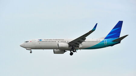 SINGAPORE - DECEMBER 25: Garuda Indonesia Boeing 737-800 landing at Changi Airport on December 25, 2013 in Singapore