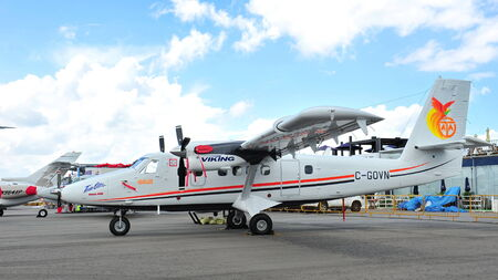 turboprop: SINGAPORE - FEBRUARY 12  Viking Air DHC-6 Twin Otter Series 400 turboprop south pole capable aircraft on display at Singapore Airshow February 12, 2012 in Singapore