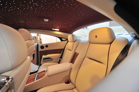 SINGAPORE - APRIL 12: Rear leather seats with star ceiling of the Rolls Royce Wraith on display during Singapore Yacht Show at One Degree 15 Marina Club Sentosa Cove April 12, 2014 in Singapore