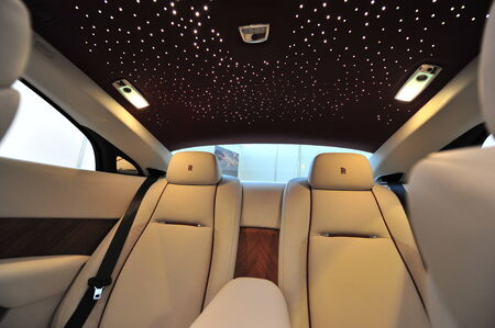 wraith: SINGAPORE - APRIL 12: Rear leather seats with star ceiling of the Rolls Royce Wraith on display during Singapore Yacht Show at One Degree 15 Marina Club Sentosa Cove April 12, 2014 in Singapore