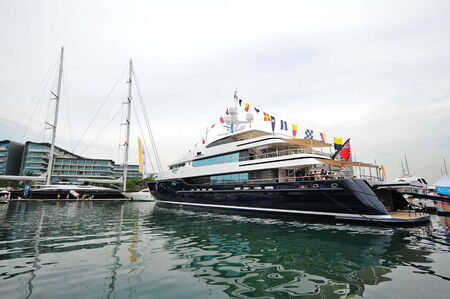 super yacht: SINGAPORE - APRIL 12: Burgess Cloud 9 super yacht making its Asian debut during Singapore Yacht Show at One Degree 15 Marina Club Sentosa Cove April 12, 2014 in Singapore Editorial