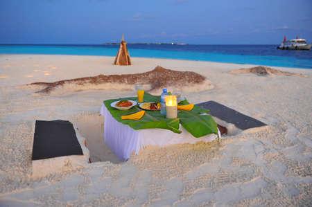 animal private: Romantic dinner on a private island in Maldives Stock Photo