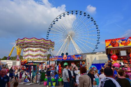 calais: LILLE - SEPTEMBER 13: People enjoying themselves at the Lille amusement park on September 13, 2014 in Lille, France