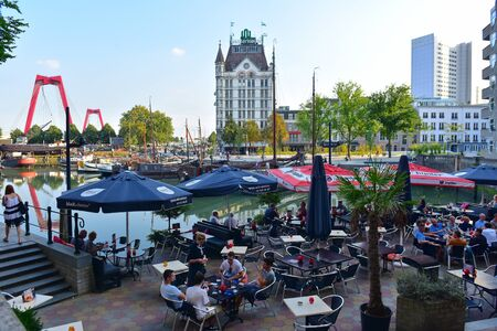 alfresco: ROTTERDAM - SEPTEMBER 18: Diners enjoying alfresco dining with a view of the Witte Huis (White House) at Wijnhaven, taken on September 18, 2014 in Rotterdam, Netherlands
