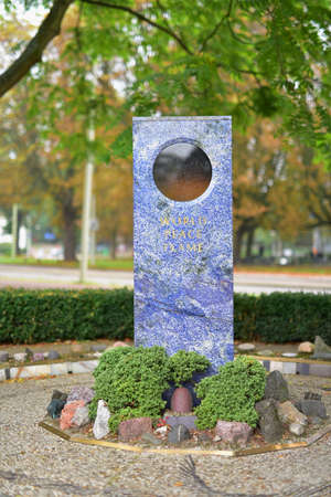eternal: HAGUE - SEPTEMBER 19: Eternal world peace flame installed in front of the gates of Peace Palace, taken on September 19, 2014 in Hague, Netherlands
