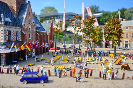 minature: HAGUE - SEPTEMBER 19: Scaled replica of Alkmaar Cheese Market at Madurodam minature park, taken on September 19, 2014 in Hague, Netherlands