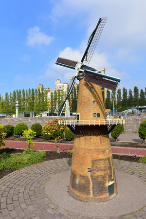 minature: HAGUE - SEPTEMBER 19: Scaled replica of a windmill at Madurodam minature park, taken on September 19, 2014 in Hague, Netherlands