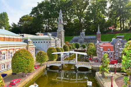 minature: HAGUE - SEPTEMBER 19: Scaled replica of traditional Dutch canal houses at Madurodam minature park, taken on September 19, 2014 in Hague, Netherlands Editorial