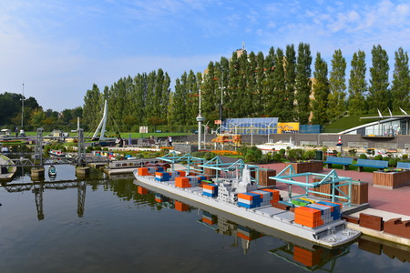 euromast: HAGUE - SEPTEMBER 19: Scaled replica of Port of Rotterdam, Euromast Tower and Erasmus Bridge at Madurodam minature park, taken on September 19, 2014 in Hague, Netherlands