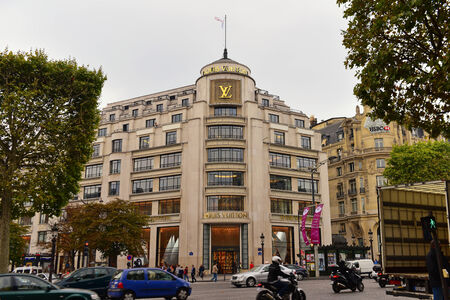 elysees: PARIS - SEPTEMBER 24: Facade of Louis Vuitton flagship store along Champs Elysees, taken on September 24, 2014 in Paris, France Editorial