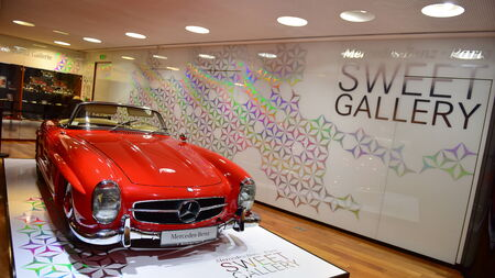 elysees: PARIS - SEPTEMBER 24: Red classic 300 SL on display at the Mercedes Benz gallery along Champ Elysees, taken on September 24, 2014 in Paris, France Editorial