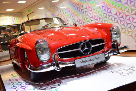 champ: PARIS - SEPTEMBER 24: Red classic 300 SL on display at the Mercedes Benz gallery along Champ Elysees, taken on September 24, 2014 in Paris, France Editorial