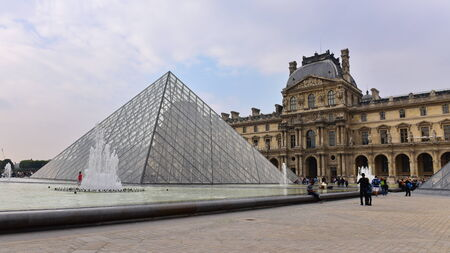 louvre pyramid: PARIS - SEPTEMBER 24: The Louvre Palace and the Pyramid, one of the worlds largest museums and central landmark, taken on September 24, 2014 in Paris, France Editorial