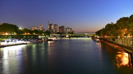 river scape: PARIS - SEPTEMBER 25: View of Paris night scape along La Seine river, taken on September 25, 2014 in Paris, France