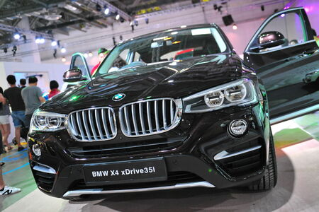 sport utility vehicle: SINGAPORE - AUGUST 2: BMW X4 compact luxury crossover SUV vehicle on display at BMW World 2014, taken on August 2, 2014 in Singapore