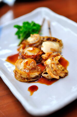 hotate: Japanese grilled hotate (scallop) skewers served on a plate