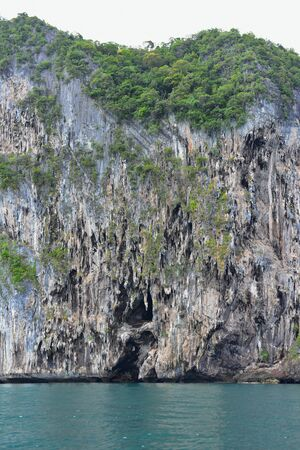 steep cliff: Hilly island at Andaman Sea with steep cliff walls Stock Photo