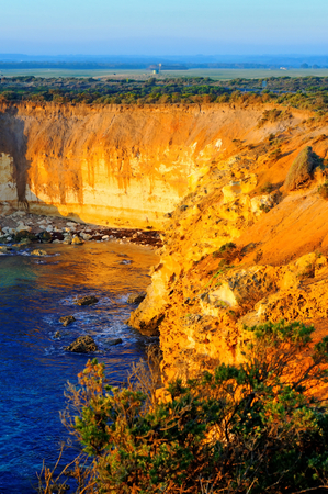 steep cliffs: Steep cliffs and flat plains near Great Ocean Road, Australia