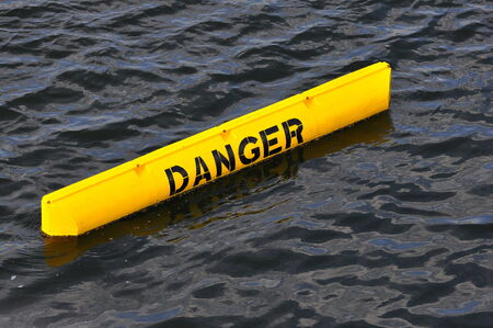 inform information: Yellow danger sign floating in the sea Stock Photo